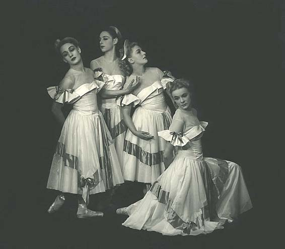4 dancers including Laurel Martyn, kneel and pose together in their costumes for BALLADE