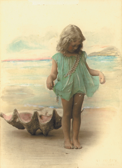 Laurel Martyn, performing at 4 years of age in front of a seashell