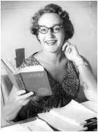 Laurel Martyn sits with a book, smiling at the camera