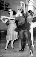Laurel Martyn holds a dancers hands in a grand pose